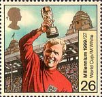 Millennium Series. The Entertainers' Tale 26p Stamp (1999) Bobby Moore with World Cup ('Sport')